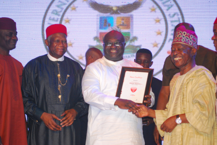Okezie Ikpeazu,governor of Abia state(middle) receiving his award from Sam Amuka-Pemu