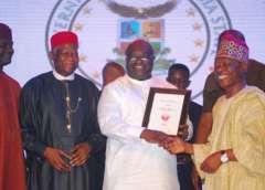 Okezie Ikpeazu,governor of Abia state(middle) receiving his award from Sam Amuka-Pemu