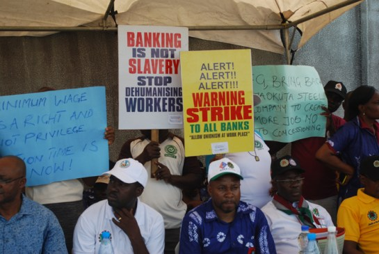 workers displaying placards