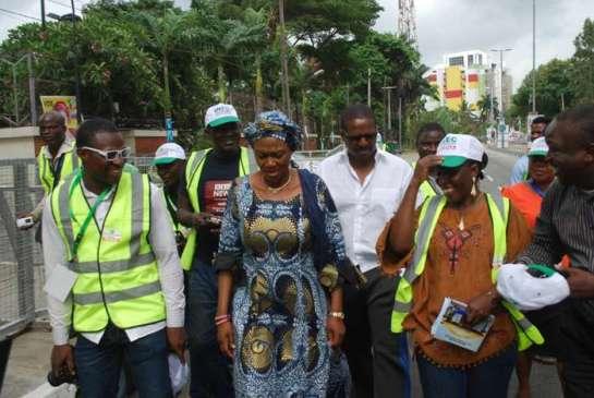 Senator Oluremi Tinubu(middle) being flaked by Journalist