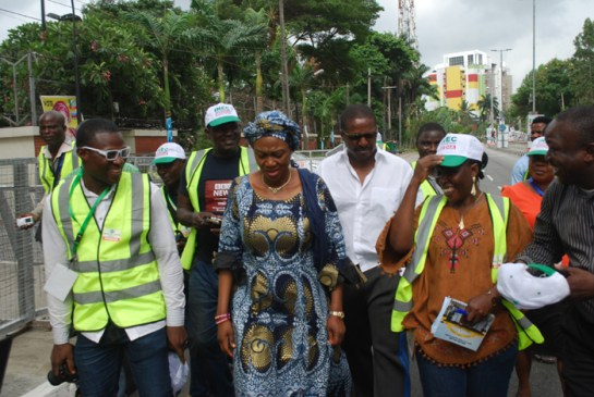 Senator Oluremi Tinubu(middle) being flaked by Journalist