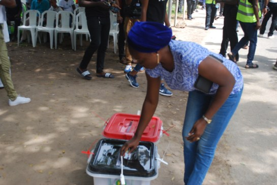 A voter casting her vote