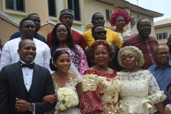 Nkechi Obi flanked by family members