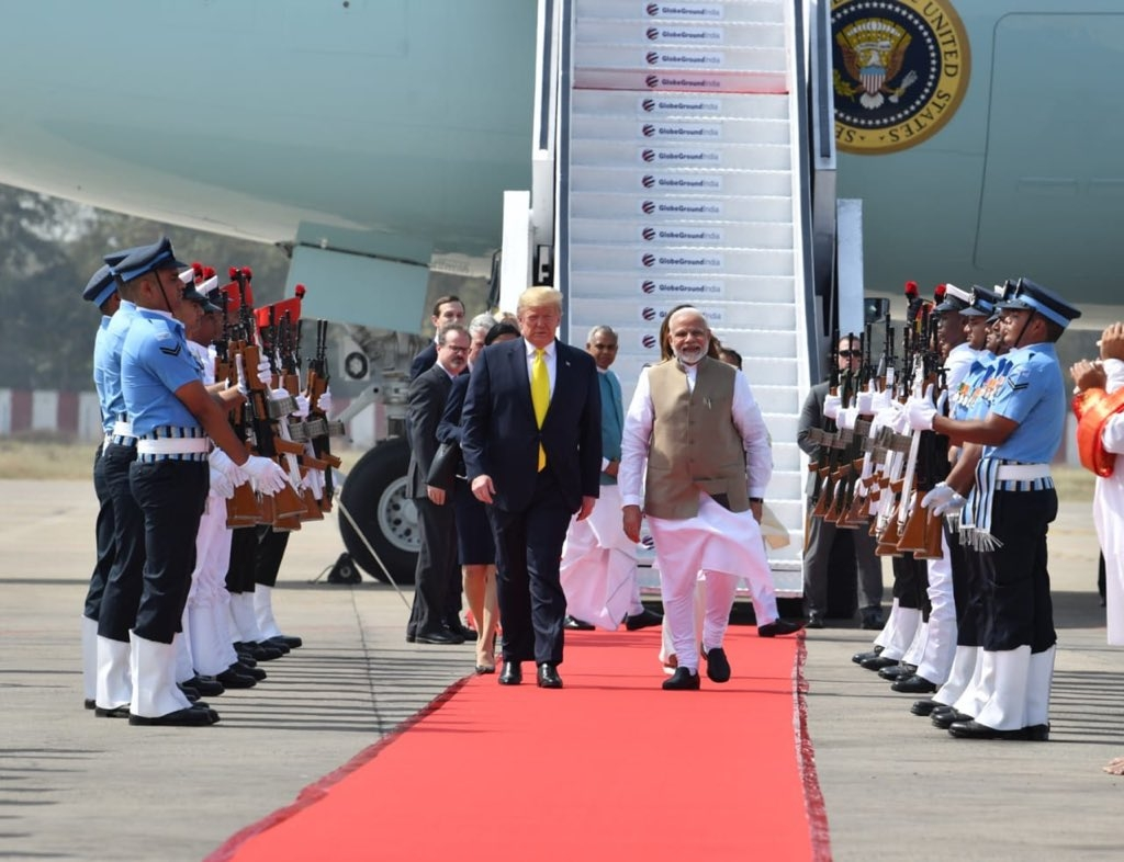 Ahmedabad: Prime Minister Narendra Modi receives US President Donald Trump and First Lady Melania Trump on their arrival at the Sardar Vallabhbhai Patel International Airport in Ahmedabad on Feb 24, 2020. A red carpet welcome was given to Trump and Melania on Monday amid sounds of conch shells after their Air Force One landed at Ahmedabad Airport. Trump is accompanied by his daughter Ivanka and a 12-member delegation. (Photo: IANS/MEA)