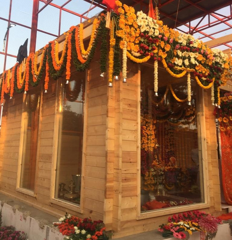 Ayodhya: The idol of Ram Lalla was shifted to the new makeshift temple on the first day of 'Navratri', amid pealing of bells and clanging of gongs, at Manas Bhawan in Ayodhya at 4.a.m on March 25, 2020. The deity has been seated on a silver throne, weighing about 9.5 kilograms. The throne has been 'gifted' by the Raja Ayodhya Vimlendra Mohan Mishra, who is also a member of the Shri Ram Teerth Kshetra Trust. The intricately carved throne has been made by artisans from Jaipur. (Photo:IANS)