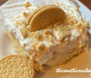 GOLDEN OREO POKE CAKE