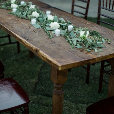 fall wedding table decor outside seating area flower arrangements