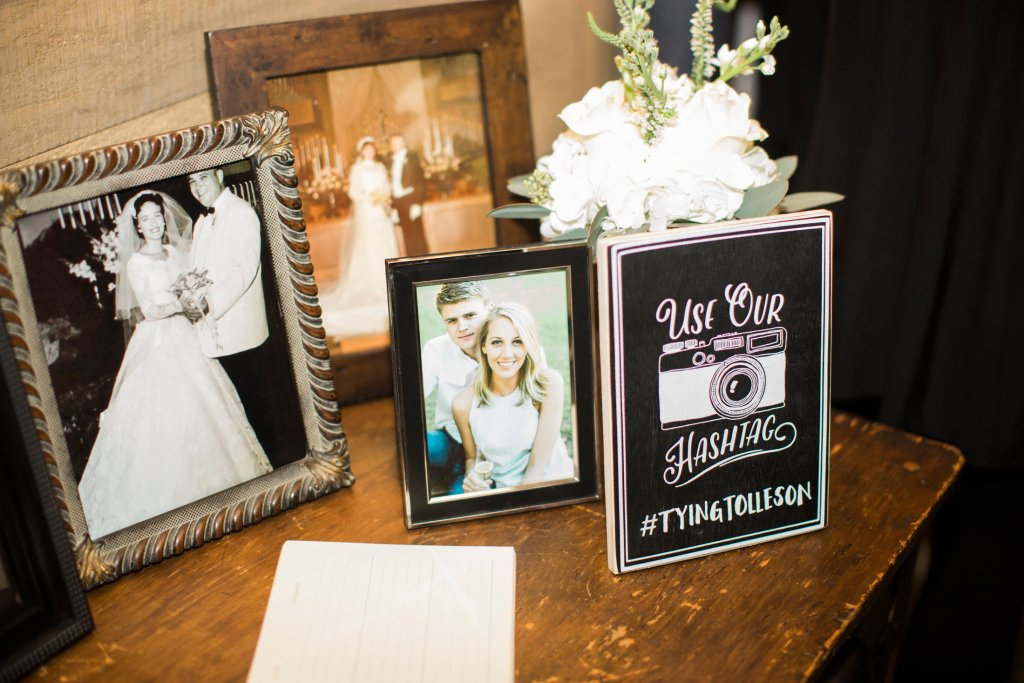 old family pictures on display at wedding reception