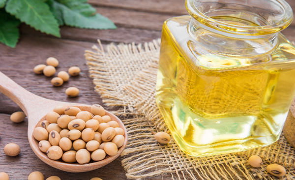 An image depicting soybean oil in a glass container
