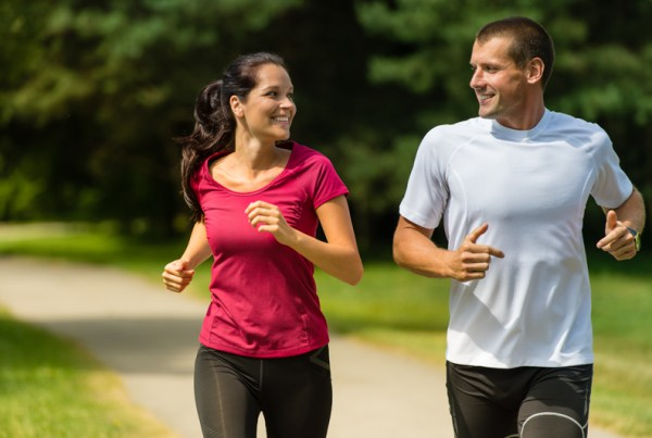 An image depicting two people running.