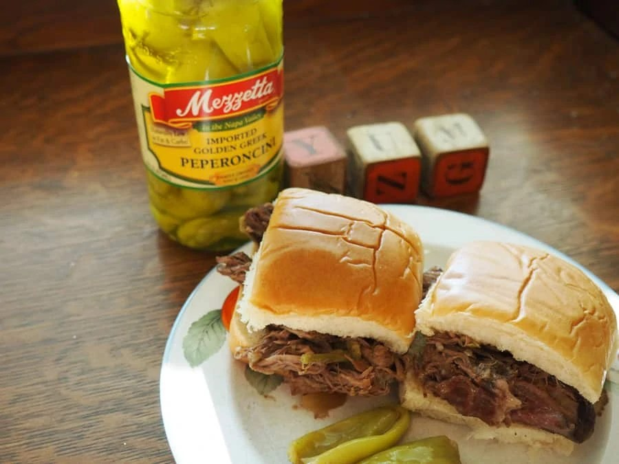 slow cooker beef peppercini sliders: I put this on before I went to bed and my house smelled wonderful when I woke up!! I shredded the meat to put them on sliders. This was a childhood favorite and a big hit with my family! | via The Spirited Violet
