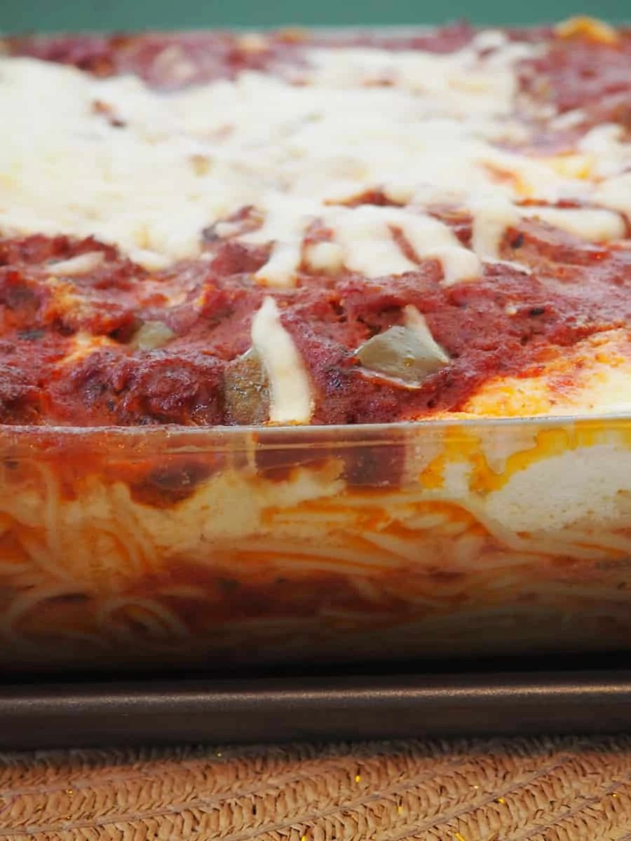 Try this delicious spaghetti bake recipe! It is easy to make, rich, and sure to become a family favorite. | via The Spirited Violet
