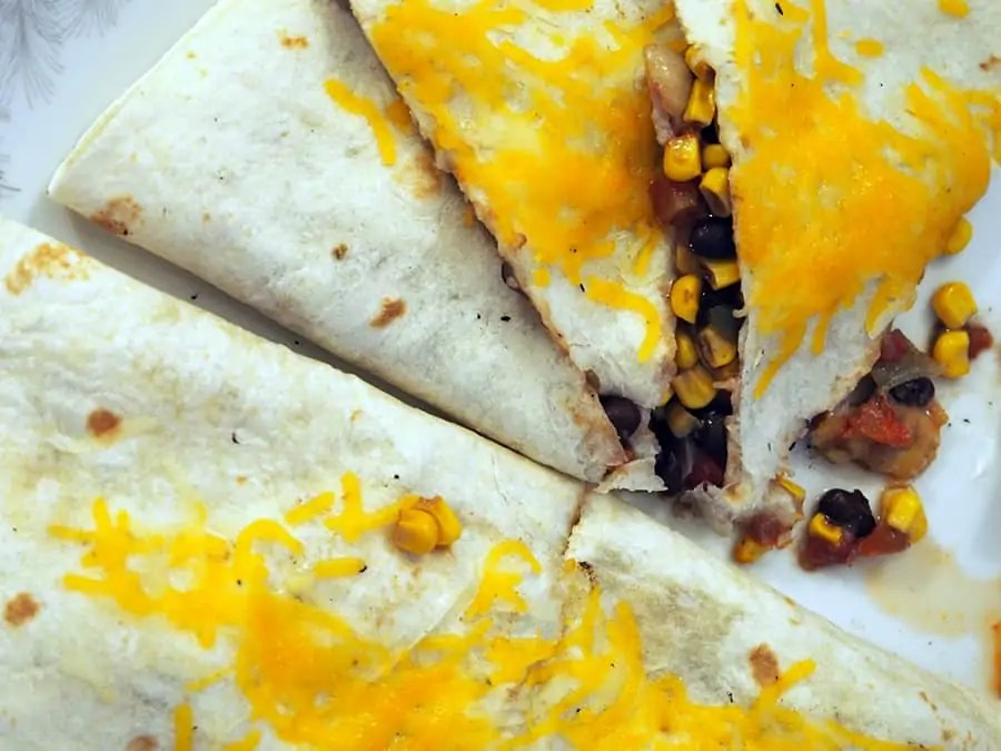 These sweet and spicy rib meat quesadillas are so delicious! Save the money and don't go to a restaurant for dinner. Make these instead! | via The Spirited Violet