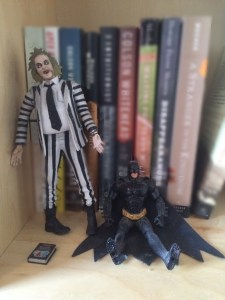 This is part of my bookshelf. It's actually a Christian Bale doll because I lost the Michael Keaton guy back in the day.