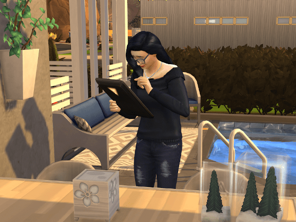 A Sim practicing painting on the digital sketch pad tablet from the Style Influencer career