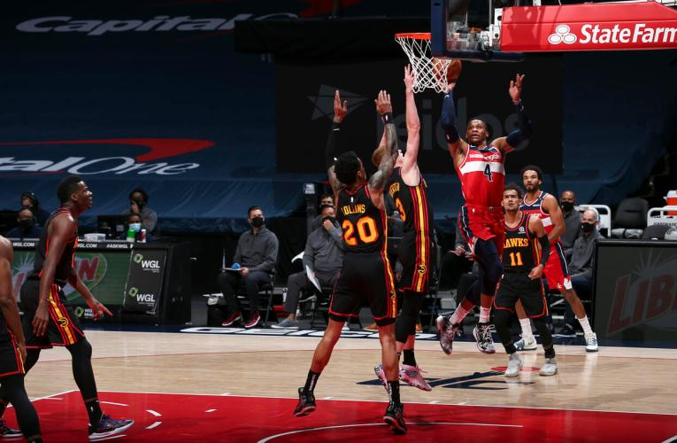 Wizards lose fourth straight as Young leads Hawks to victory