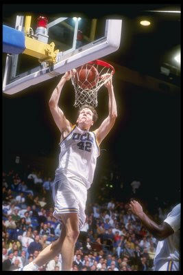 Don Maclean in UCLA white number 42 dunking.  Listen about UCLA's rivalry with Arizona on the Sports Rivals podcast!