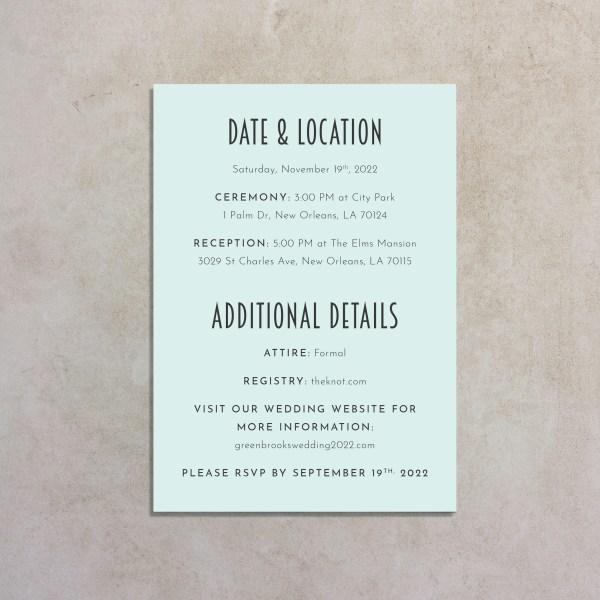 back of blue art deco wedding invitation