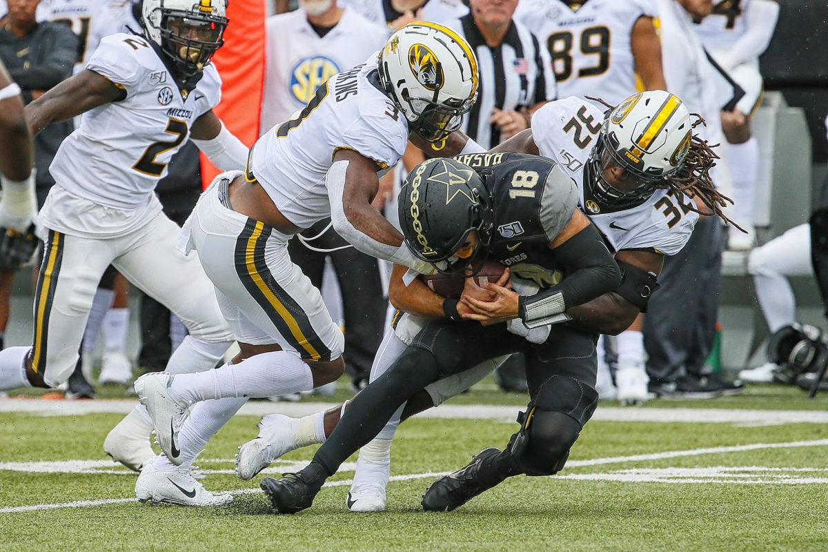 MIssouri linebacker Nick Bolton makes a sack against Vanderbilt.