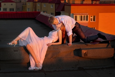 Young Couple On The Roof