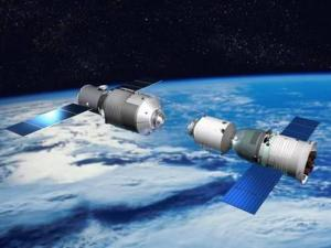 Artist's rendition of a Shenzou spacecraft preparing to dock with Tiangong-1