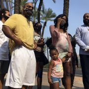 Iesha Harper said at a Wednesday news conference that she and Dravon Ames will receive $475,000 from the Phoenix City Council to settle a $10 million lawsuit they launched against the city last year
