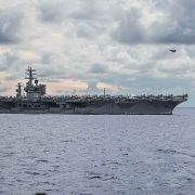 The aircraft carrier USS Nimitz (pictured) and guided-missile cruiser USS Princeton are currently conducting search and rescue operations in the North Arabian Sea following reports of a missing sailor, according to a statement from the Navy