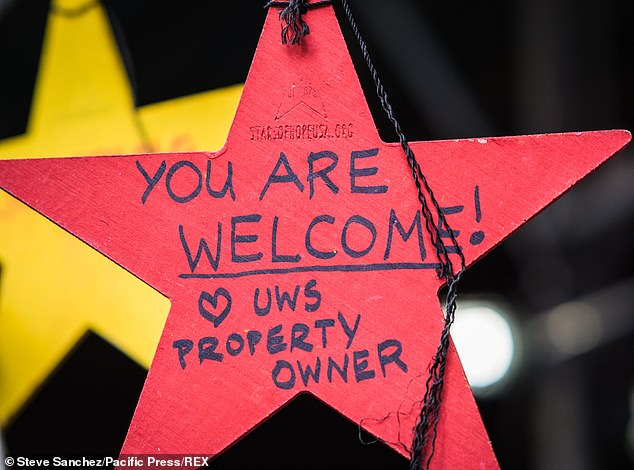 Supporters also wrote messages of solidarity on stars hung on scaffolding outside the hotel