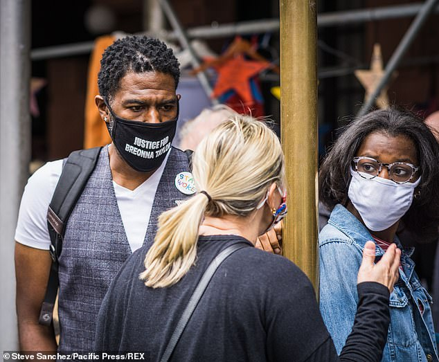 A woman is seen confronting city Public Advocate Jumaane Williams and another supporter of the homeless during Sunday's tense demonstration
