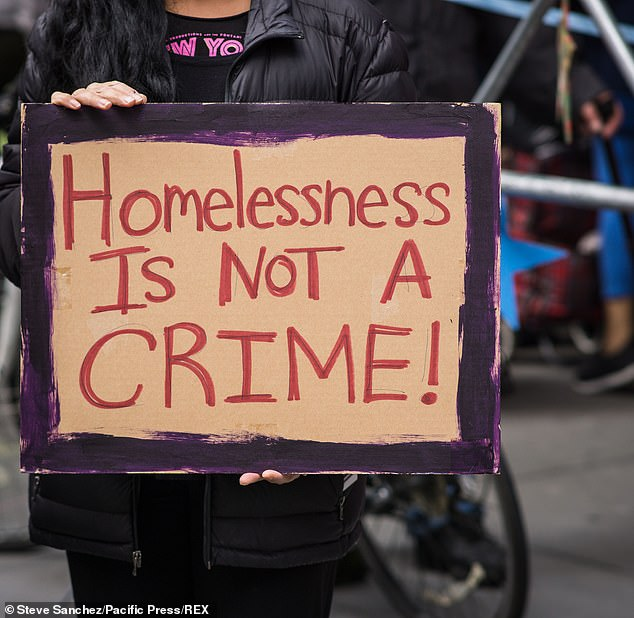 Supporters held signs with messages of kindness, including 'Homelessness is not a crime!'