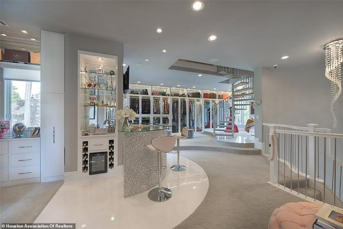 At the heart of Roemer's closet sits a champagne bar with storage space for 12 bottles