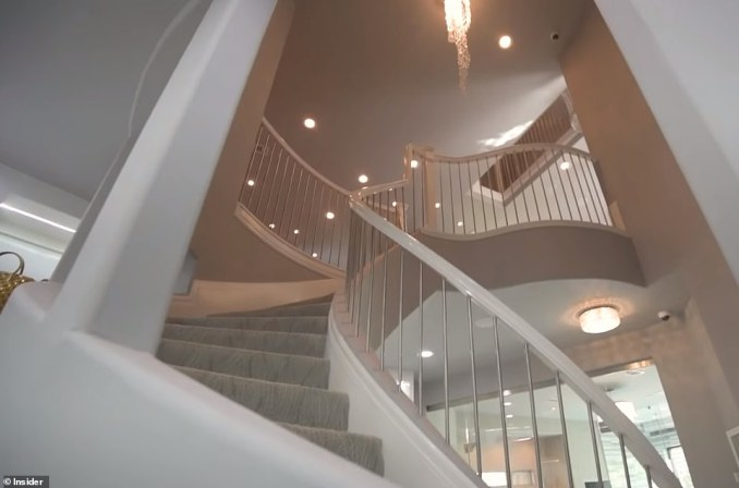 The closet features a floating staircase, a champagne bar and a decked-out hair and makeup studio