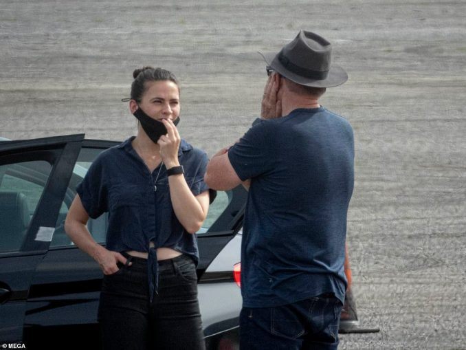 New movie: Hayley was seen on set in a blue shirt and black jeans as she chatted to directorChristopher McQuarrie with her mask on