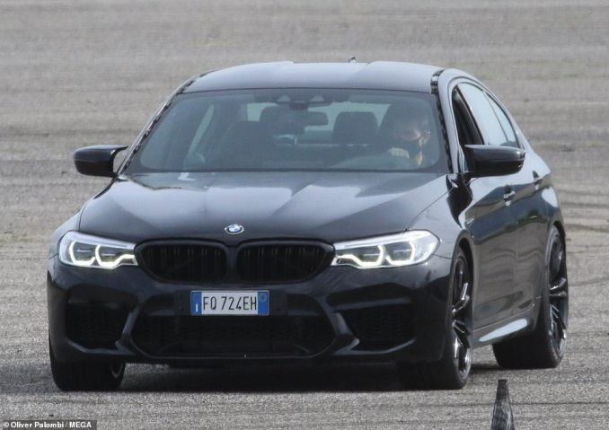 Smooth: Tom looked cool and in control as he made his way around the set in a smart black BMW