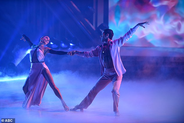 Rumba routine: Nev Schulman and Jenna Johnson earned 24 points for their rumba to Celine Dion's Because You Loved Me