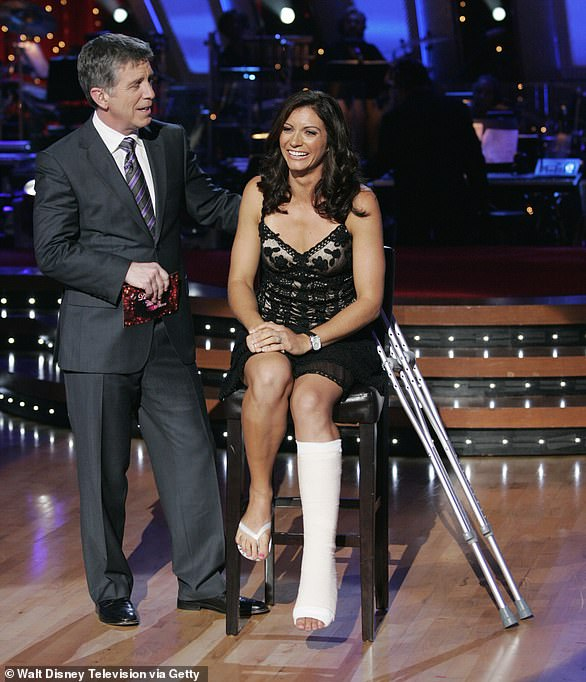 Rehearsal injury: Misty May-Treanor is shown with host Tom Bergeron in October 2008 as she revealed rupturing her Achilles tendon during practice on Dancing With The Stars