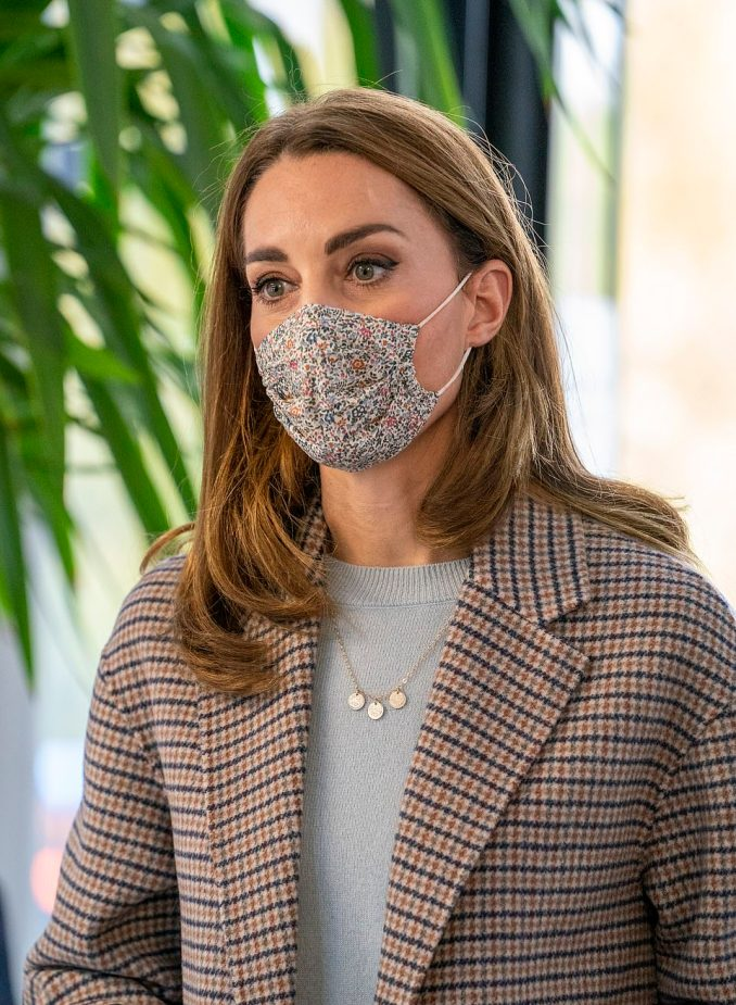 The Duchess of Cambridge (pictured), who donned a patterned face mask, wrapped up warm in a check coat, light blue jumper and jeans
