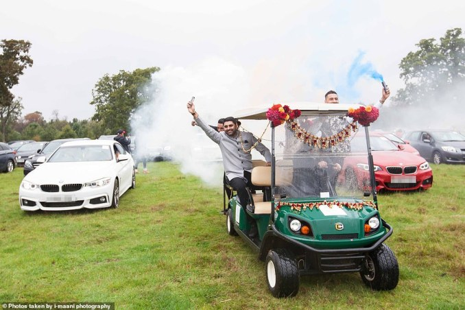 During the four-hour Hindu wedding, they could order food from a dedicated website to be delivered by waiters, but were only allowed to leave their vehicles only to use toilet cabins. Pictured are guests driving around with flares