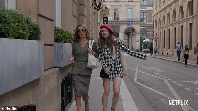 Netflix fans have criticised new hit show Emily in Paris for portraying all French people as rude (pictured, Lilly Collins as Emily andPhillippine Leroy-Beaulieu as Sylvie Grateau