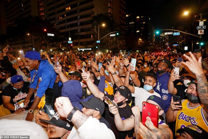 Thousands flooded the streets in downtown Los Angeles, ignoring earlier warnings from public health officials for fans to celebrate at home