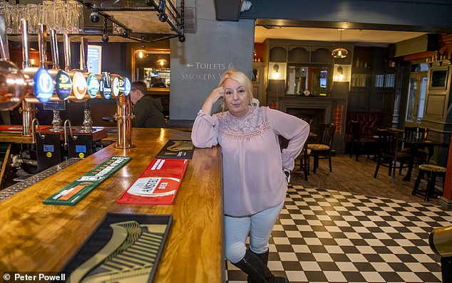 Manager Karen Strickland (above) of The Grapes,where The Beatles used to drink, said she was 'absolutely heartbroken' after watchingBoris Johnson's TV announcement