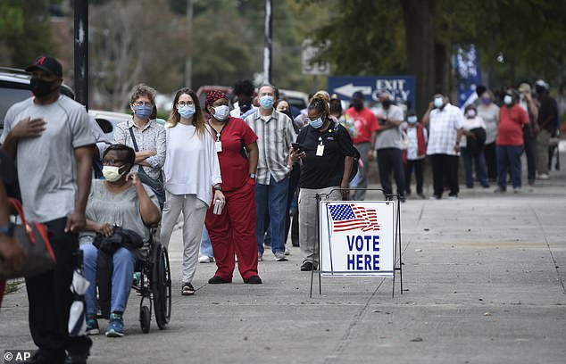Monday was the first day for advance voting in Georgia and people showed up by the hundreds to cast their ballot early at the Bell Auditorium in Augusta