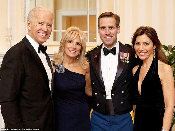 Hunter's older brother Beau died from a brain tumor in June 2015. In October Joe Biden announced he would not be running for president, to succeed Barack Obama in 2016. He said he was so cut up about Beau's death he couldn't put his heart into a campaign. Pictured: Biden with his wife Jill, late son Beau and his widow Hallie in 2012