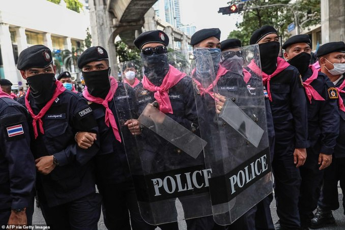 Police armed with riot shields face off with demonstrators in Bangkok on a second continuous day of protests aimed at reforming the government and the monarchy
