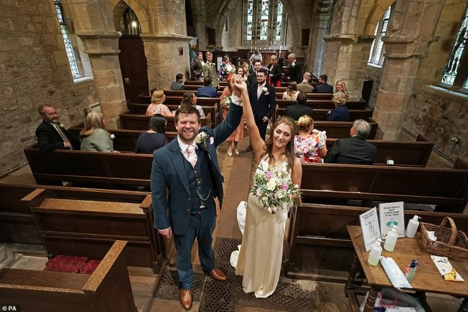 The newly married Lucy and James Bone after their wedding at St Michael and all Angels Church in Ingram, Northumberland, on July 4 - the that weddings were once again permitted