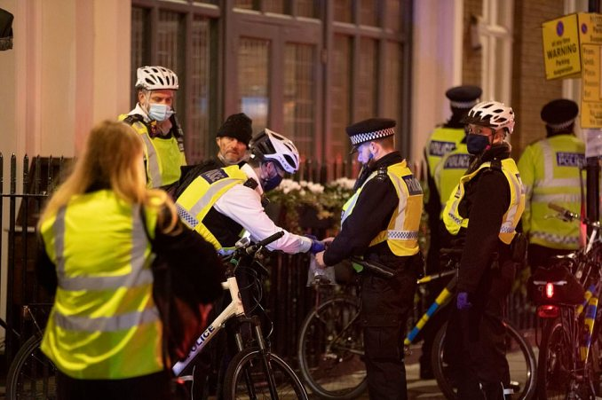 A group of police officers wearing face coverings patrol Soho's streets on bicycles on the night before the capital is plunged into Tier Two restrictions