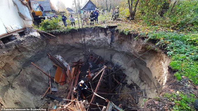 'She fell underground with the house': A survivor told a local newspaper of how her maternal aunt disappeared when the house vanished into the enormous sinkhole
