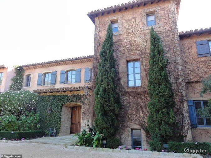 The estate has sweeping lawns, tiered rose gardens, tall Italian cypress trees, blooming lavender, century old olive trees, a tennis court, tea house, children's cottage and a pool