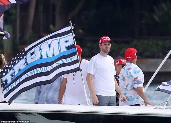 Law and Order: Eric donned a red Make America Great Again cap as he stood in front a Blue Lives Matter flag as it flapped in the breeze