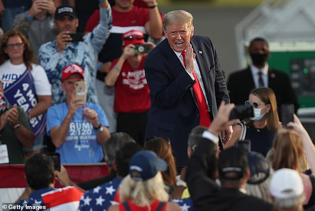 Trump is already trailing Democratic rival Joe Biden in the polls with less than three weeks to go until the election. Pictured at his campaign event in Florida Thursday daytime